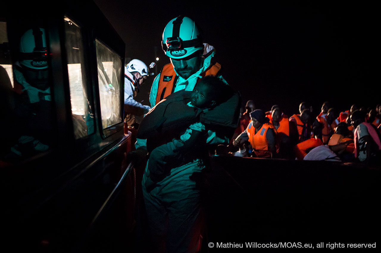 baby-being-rescued-at-night-in-Central-Mediterranean-copyright-Mathieu-Willcocks_MOAS-2016-0191