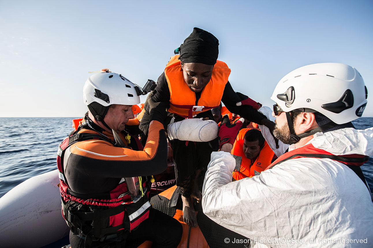 injured-woman-migrant-being-helped-in-Central-Mediterranean-copyright-Jason-Florio_MOAS-2016-5229