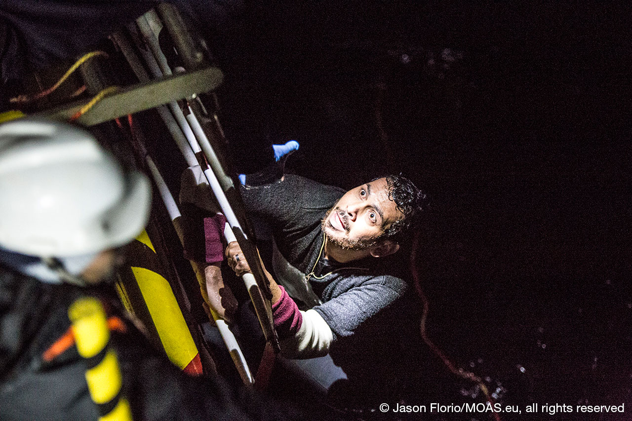 migrant-rescued-in-Aegean-Sea-climbing-the-ladder-on-responder-copyright-Jason-Florio_MOAS-2016-6301