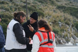MSF France Dr Ludvik and Dr Giada confer with Greek Coast Guard authorities to make sure the wounded are cared for