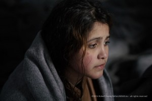 A Syrian refugee girl in a shelter on Agathonisi.  Although they have crossed the Aegean a long difficult trip awaits the over one million migrants and refugees who make to trip to Europe.