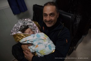 MOAS crew member Mimmo takes special care of the sleeping infant who had been revived from life threatening hypothermia. Many of the casualties are children like the two year old boy Khalid, who was swept overload and transported in the Responder's morgue.