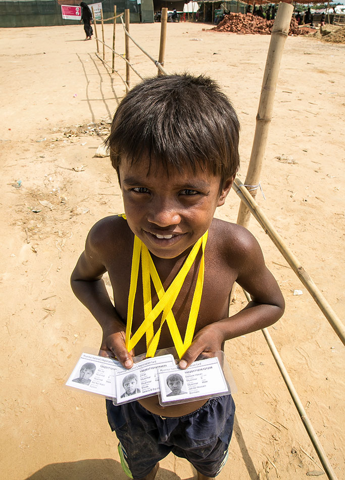 moas-Rohingya-refugee-child-holding-identity-cards