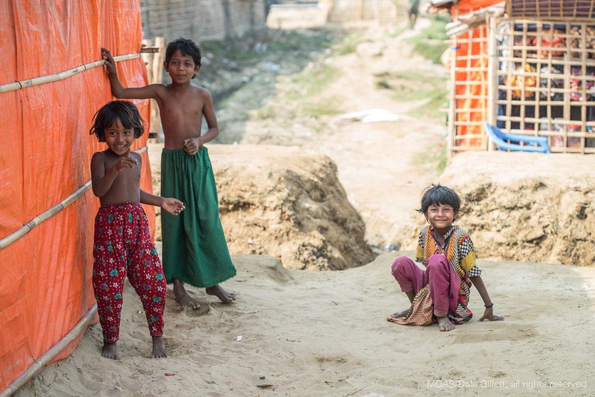 three-rohingya-refugee-children-play-in-shamlapur-camp-cox-bazar-bangladesh-07368_copyright_MOAS_Dale-Gillett