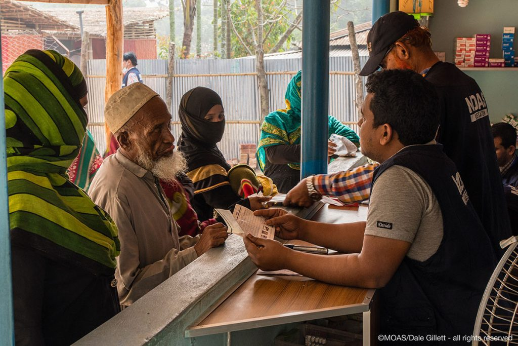 Rohingya people collect their medication from the MOAS pharmacy at the Shamlapur Aid Station.