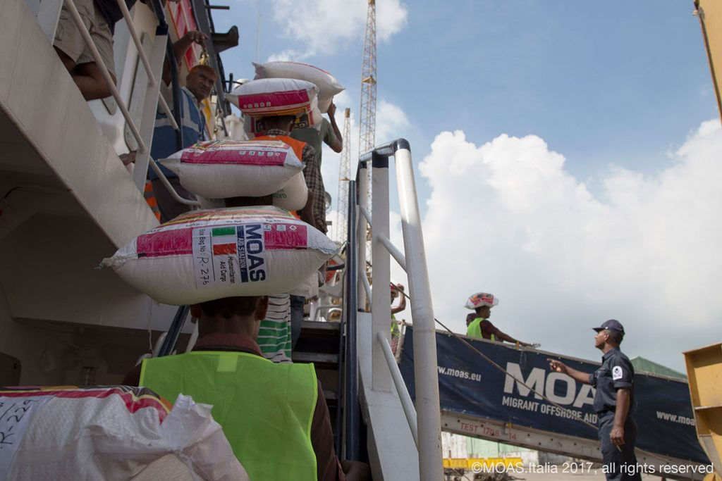 Food is taken from the Phoenix after MOAS had delivered 20 tonnes of food aid to the Bangladeshi authorities.