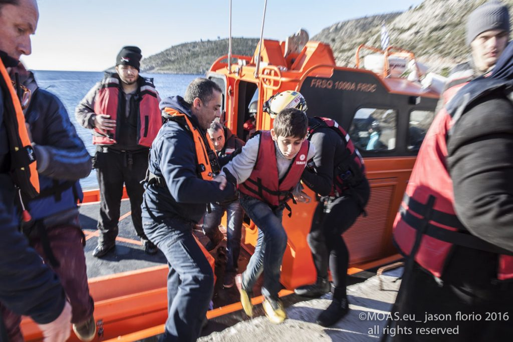 Refugees who had been attempting to cross the Aegean Sea are helped onto dry land by MOAS crew.